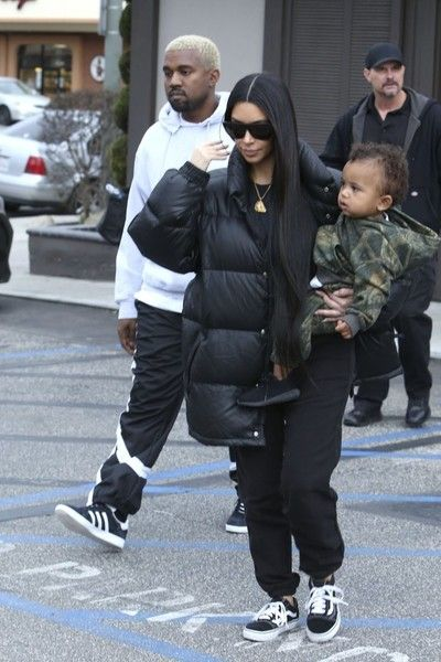 Kim Kardashian Photos Photos - Reality stars Kim and Kourtney Kardashian take their kids to have lunch with Kim's husband Kanye West at Something's Fishy in Woodland Hills, California on February 19, 2017. The family was bundled up against the cold winter weather. - Kim And Kourtney Kardashian Meet Kanye West For Lunch In Woodland Hills