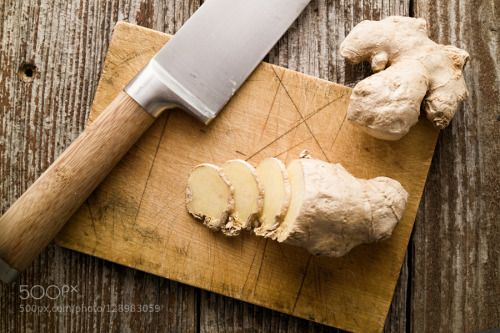 Sliced ginger and knife on rustic cutting board top view by lukam  IFTTT 500px brown chefs knife cooking cut cutting board delicious diet folk medicine food fresh gi