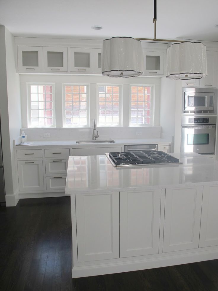 Inspirational White Shaker Cabinets with White Quartz Countertops