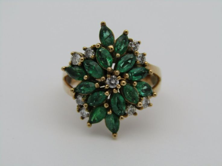 14kt gold emerald and diamond ring.