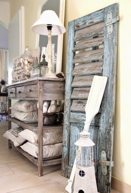 vintage shutter decor leaning on wall love the rustic beach house Best 25  Beach furniture ideas Pinterest