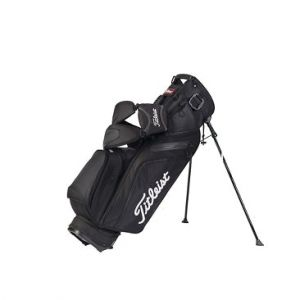 TITLEIST ULTRA LIGHTWEIGHT STAND BAG. Weight: 4.9 pounds This Ultra Lightweight Stand Bag will surpass your wildest expectations. Weighing just under 5 lbs., it has all the features of a larger stand bag design. Full apparel and ball pockets, double strap, beverage sleeve and a broad foot stand mechanism make this bag the perfect choice for the serious walker. All Titleist® golf bags easily fit in the well of motorized golf carts. The Titleist Ultra Lightweight Stand Bag is…