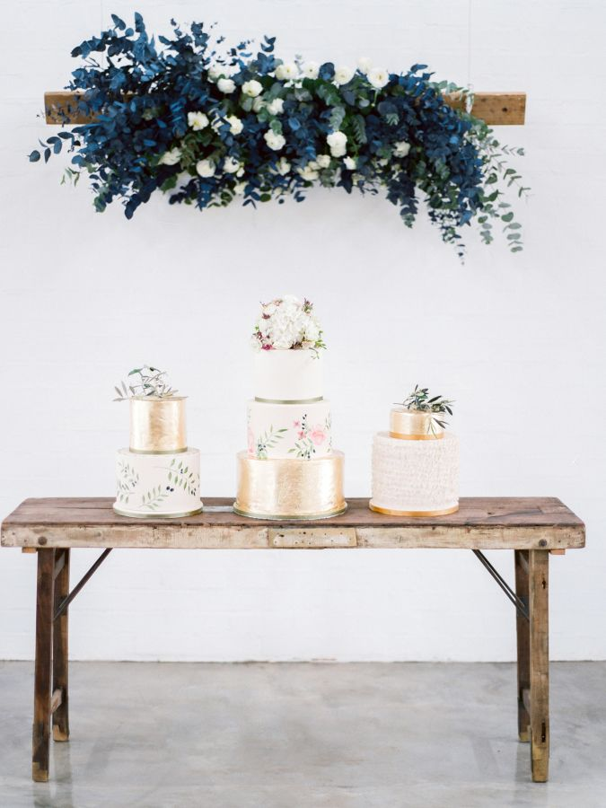 Blue florals and chic gilded cakes: http://www.stylemepretty.com/2015/11/03/rustic-chic-south-african-wedding/ | Photography: Rensche Mari - http://www.renschemari.com/