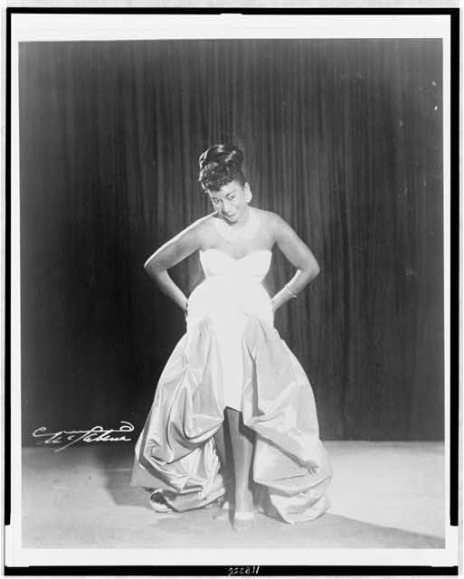 Celia Cruz, full-length portrait, facing front, on stage. Photograph. [1962]. New York World-Telegram and the Sun Newspaper Photograph Collection. Library of Congress Prints and Photographs Division.