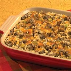 Hearty Sausage and Rice Casserole - Combine sausage, mushrooms, celery, peppers, onions, thyme, chicken broth, cream of mushroom soup, long grain wild rice and cheddar cheese.