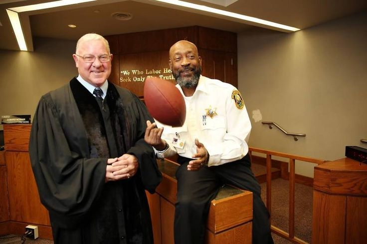 Former Miami Dolphins player Tony Nathan is now a bailiff in the Miami-Dade courtroom of Judge Edward Newman.