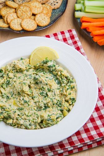 Spinach and Artichoke Hummus ~ A creamy and healthy hummus dip with all of the flavours of a spinach and artichoke dip without any of the regret. ~ chickpeas, garlic, tahini, lemon juice, olive oil, spinach, artichoke hearts, asiago or parmigiano reggiano (parmesan), cayenne, salt and pepper to taste
