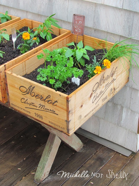 DIY Deck / herb garden using wine boxes.  Genius! Where do i find old wooden wine boxes?