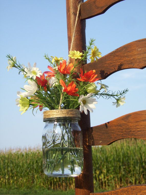 Mason Jar Wedding Decorations- These would be great for aisles, maybe one every other row of chairs. With different flowers