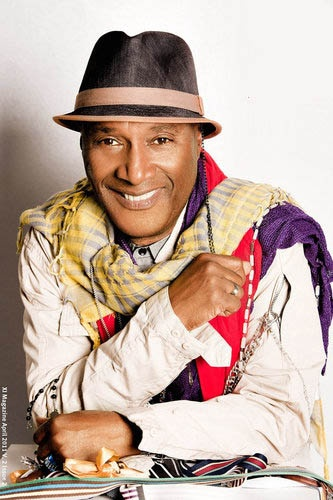 Paul Mooney (born Paul Gladney), American comedian, writer, social critic, and TV & film actor. He wrote for The Richard Pryor Show, In Living Color, Sanford and Son, & Good Times. He also co-wrote Richard Pryor's material for the Live on the Sunset Strip, Bicentennial Nigger, & Is It Something I Said albums, SNL appearances, & Jo Jo Dancer, Your Life Is Calling film. His acting roles include Hollywood Shuffle, Which Way Is Up?, Bustin' Loose, Bamboozled, & Chappelle's Show in skits 'Ask A…