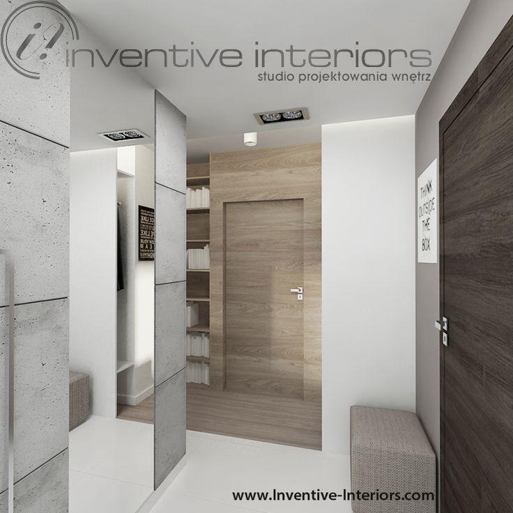 Projekt przedpokoju Inventive Interiors - ściana z drzwiami w fornirze i propozycja lustra wkomponowanego w dekoracyjny beton na ścianie