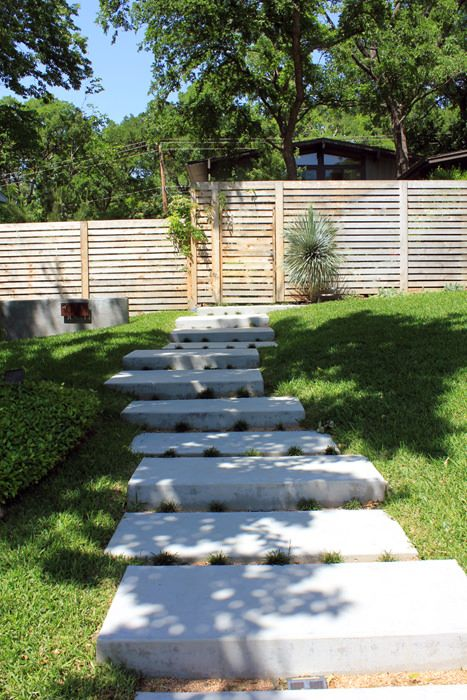 Concrete slabs to create a contemporary look with these floating concrete stairs