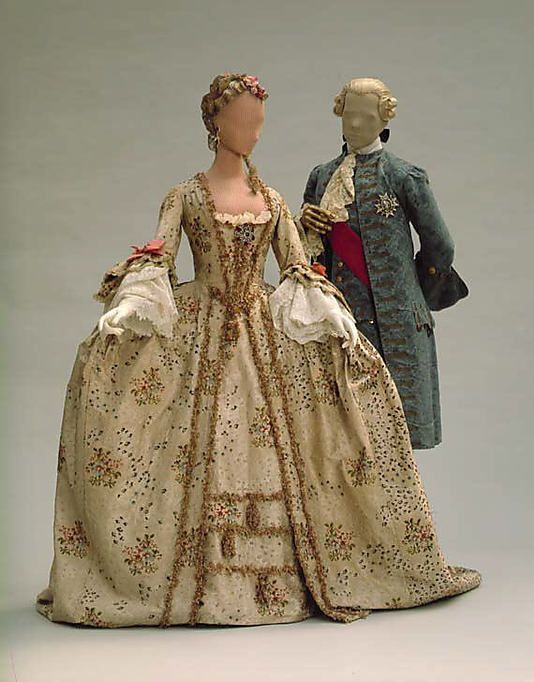 Robe a la Francaise 1770, French, made of silk and Gentleman's suit of the same period.