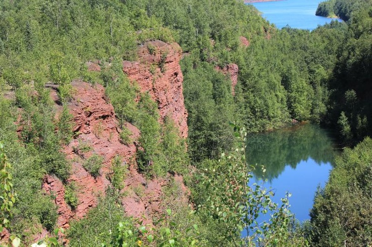 An iron ore mining pit, now a freshwater lake filled in entirely by rainwater. This isn't the one I dove into, but very similar.    Chisholm, Minnesota