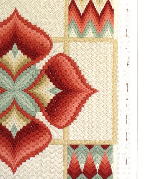 With its wonderfully warm color palette, exquisite embroidery, and modern geometric style, this very intricate art piece and needlepoint work will