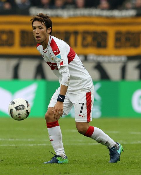 Hajime Hosogai Photos Photos - Hajime Hosogai of Stuttgart runs with the ball during the Second Bundesliga match between SG Dynamo Dresden and VfB Stuttgart at DDV-Stadion on October 15, 2016 in Dresden, Germany. - SG Dynamo Dresden v VfB Stuttgart - Second Bundesliga