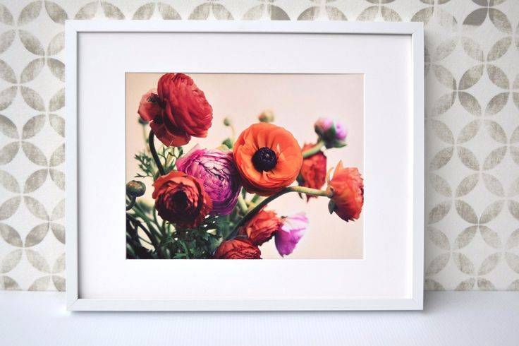 This colourful posy will brighten up a dull day and bring colour to your home. Framed in white to set off its vibrant hues. #Ranunculi #Posy
