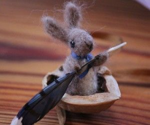 felted bunny in a walnut shell boat