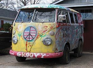 Classic Hippie Flower Power VW Bus. My neighbor painted his red, white and blue. When doing engine work he would drop it on a stump he had slid under it and then called on me to help lift the van body over it and out of the way - so easy.... ;-}