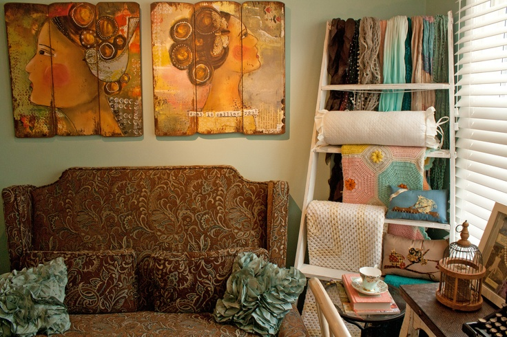 Repurpose ladder to display blankets and quilts