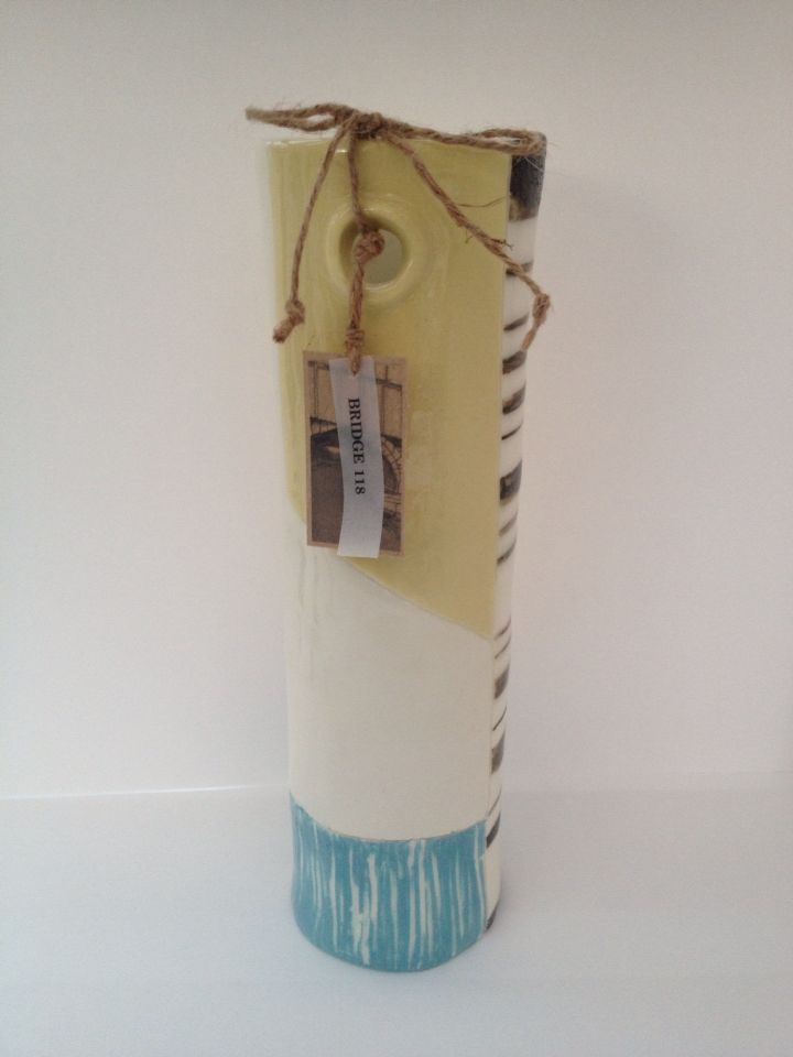 Sectional decorated ceramic/porcelain tube pot design in pastel shades and textures sections. Mustard yellow and sky blue colours. Handmade by Gabrielle Turner.