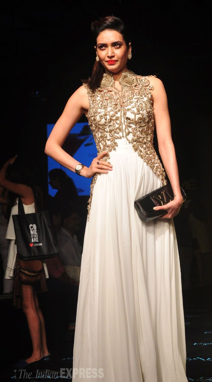 Karishma Tanna walks the ramp in a off white with golder embroidery outfit at the Lakme Fashion Week Winter/Festive 2014 finale. #Bollywood #Fashion #Style #Beauty