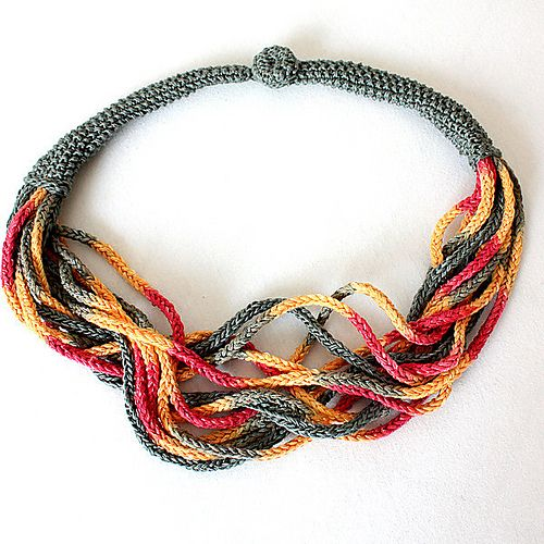 Crochet Inspiration ~ love the use of a tube to gather the individual chains