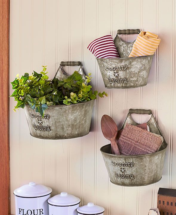 Add rustic, down-home flair to your living space with these Country Living Home Accents. The multipurpose set helps you get creative with your storage units. The Set of 3 Wall Buckets can be mounted t