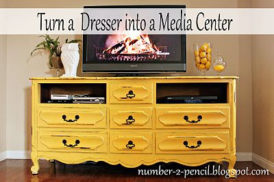 oh how I love this yellow dresser turned media center.