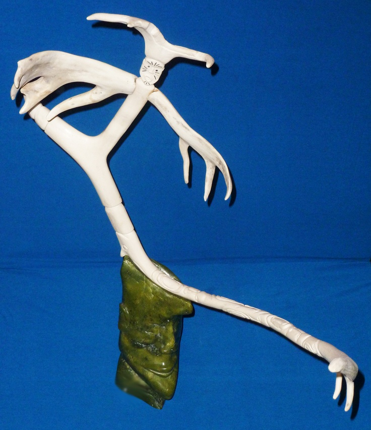 """Item # S12047 Price: C$2,950  Subject: Link   Shaman Becomes a Bird Dated: 2004 - Signed Artist: Ipeelee, Mosesee      Community:  Link   Iqaluit       Size: inches/cm 21"""" x 25"""" x 8"""" 53.3 cm x 63.5 cm x 20.3 cm   Description: Dimensions Assembled H-33 / W-30 / D-10 Stone Base alone is 12.5 x 7 x 6  This is a large whimsical yet impressive piece, a lovely addition. The bleached bone of the caribou antler is nestled into the beautiful, green serpentine base."""