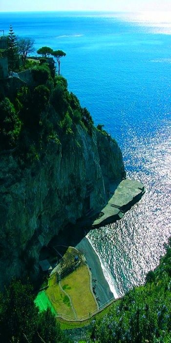 San Pietro, Positano , Italy --I just wanna jump right off that slab of rock into the beautiful water.
