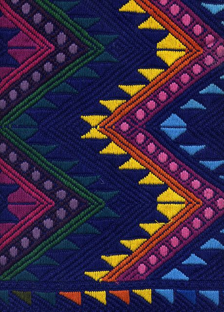 This is a mayan pattern embroidered by a designer from Guatemala. Mayan patterns were commonly seeing in archeological sites such as Palenque in Chiapas,Mexico. Cultural aspects influence different designs from all over the world