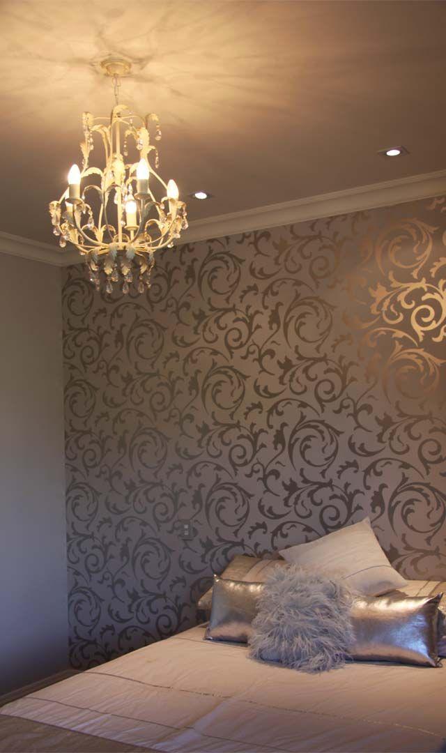 Decorative wallpaper and chandelier in the bedroom.