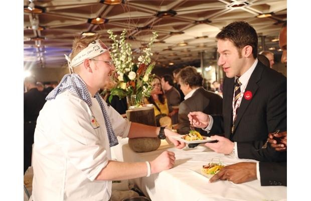 Jonathan Korecki, left,  of Sidedoor Contemporary Kitchen and Bar's wild turkey, kabocha and YOW curry explains his dish to Stuntman Stu at the Gold Medal Plates in Ottawa, Nov. 05, 2012.