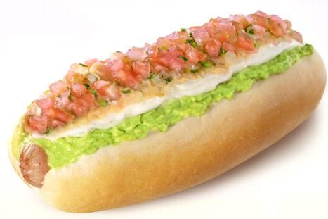Completo....(It is a sandwich which corresponds to a variation Chilean hot dog. The Completo is sausage made avocado paste or puree, tomato cut into small cubes, sauerkraut, American sauce, green sauce, among others. Some dressings are included Chilean pepper, ketchup, mayonnaise and mustard).