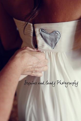 if you have a family member that is unable to be at your wedding because they have passed away you could take a blue heart shaped piece of fabric from one of their shirts and have it added to your dress so they are with you on your big day.