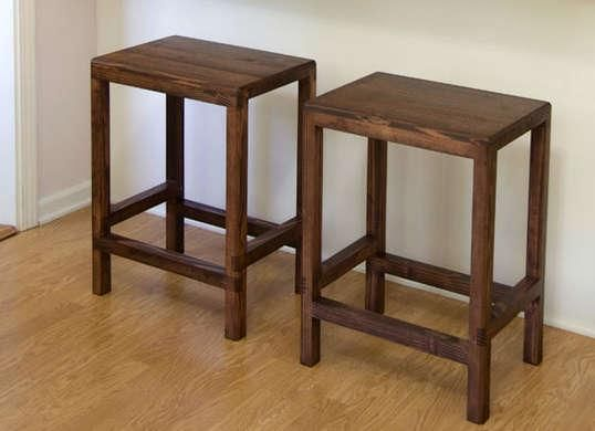 With plenty of table-saw work, a trio of 8-foot-long 2x4s can be trimmed down and transformed into a pair of slender-legged bar stools. Strips of wood were glued together to make the seats, and a stain brings out the wood grain for extra visual impact. Photo: jayscustomcreations.com RELATED: 10 Surprisingly Simple Woodworking Projects for Beginners
