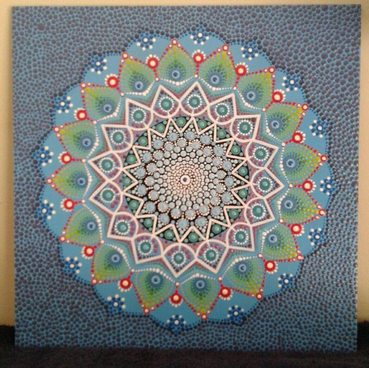 Mandala painted on a ceramic tile