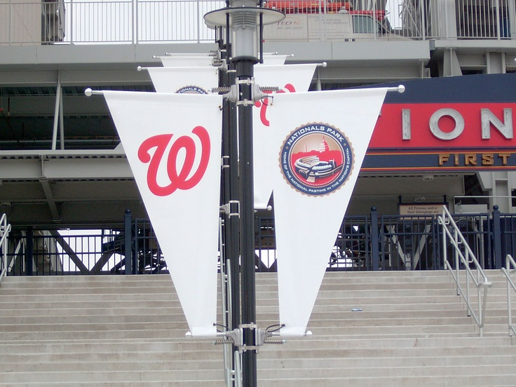 Lamp post banners installed using Britten's patented BannerSaver™ brackets.