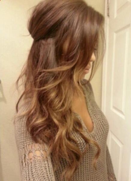 Light brown hair with ombré highlights.