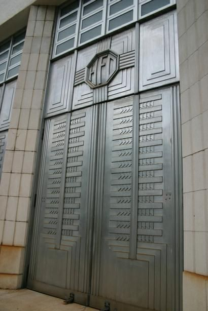 Art Deco Hawaii Fire Department the doors stand about 15 feet high not including the monogram and transome and are excellent examples of Art Deco detail.