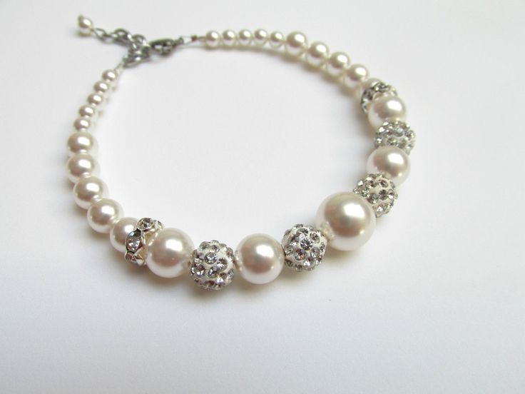 Bracelet made of Swarovski Pearls, silver plated rhinestones, shamballa Can be ordered here: https://www.facebook.com/handmadebutic
