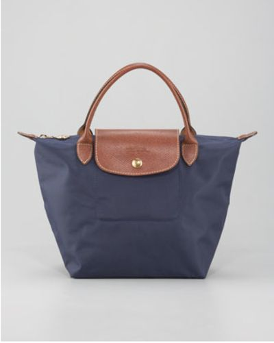 WHAT: Large Tote WHERE: Longchamp WHY: I love the size of this tote. And the best part is you can fold it up for travelling purposes!