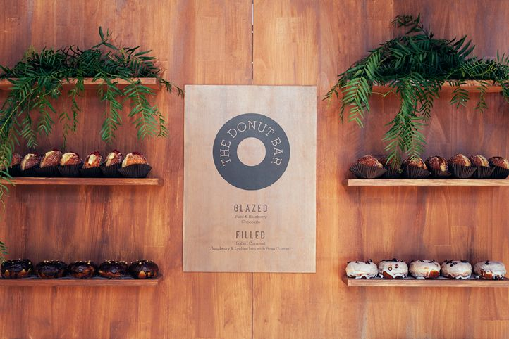 """LETTUCE & CO - STYLE. EAT. PLAY '68 reasons to party"""" - joint 50th & 18th birthday celebrations.' donut bar. donut wall. custom built timber wall structure. custom designed donut menu sign. wood menu. private party. concept design and event styling by lettuce & co."""