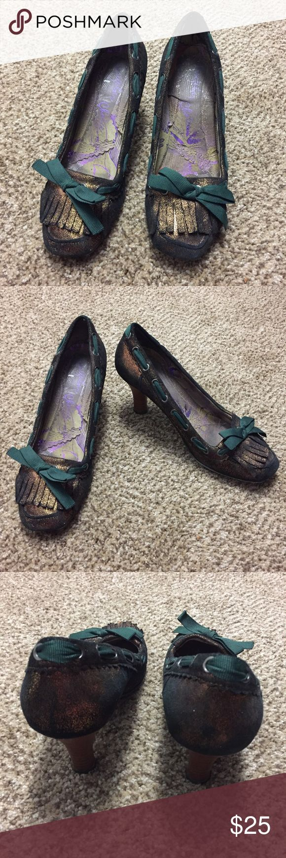 Irregular Choice Heels Great condition! Size 10 Irregular Choice heels still have plenty of wear left in them. Metallic brown color with green bow/accents. Super comfy and fun! Irregular Choice Shoes Heels