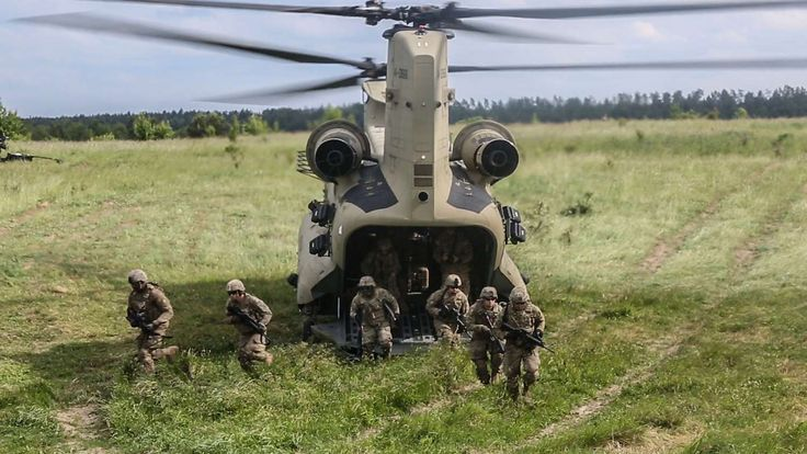 Soldiers conduct sling-load and air-assault training with M777A2 howitzers at Bemowo Piskie Training... - US Army
