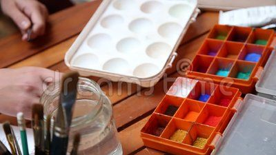 Worktable painter - colors and brushes on table