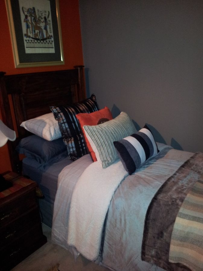 Here is a Guest bedroom entry from Cindy Hodgkiss. She decorates her own home and though she has no specific training, she knows what she likes. Good luck.