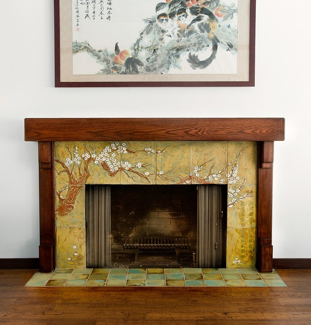 custom carved tile fireplace surround depicting a cherry tree with a Chinese poem by Cha-Rie Tang.