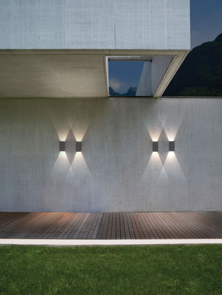 Our new LED integrated outdoor fittings brighten up an exterior space with sharp, clean lines. Place closer together to get a overlapping pattern of light.  http://ilite.co.uk/residential/oslo-160-led-grey-outdoor-wall-light.html